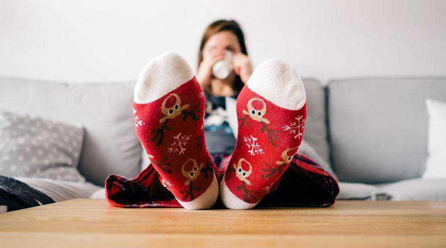 Woman Wearing Christmas Socks hd wallpaper desktop high-resolution background
