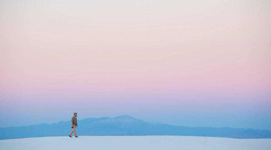 Lone Man Walking Under Pastel Sky minimal minimalistic desktop wallpaper hd 4k high-resolution
