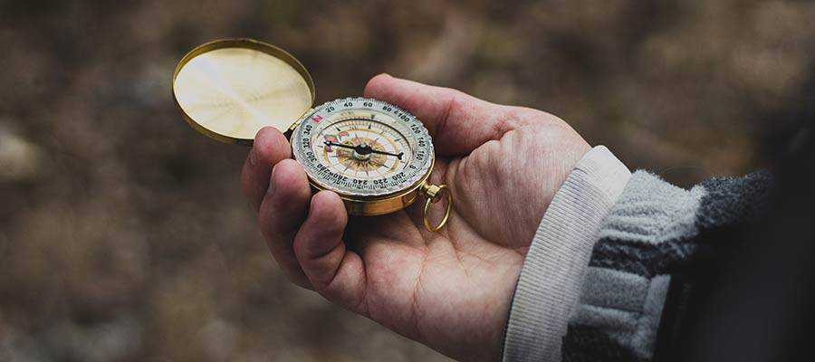 A person holding a compass.
