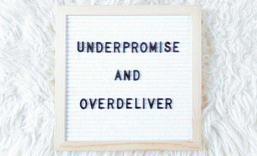 Under-promise over-deliver sign