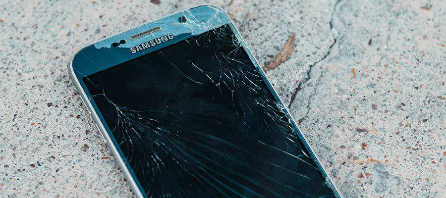 A cell phone with a cracked screen.