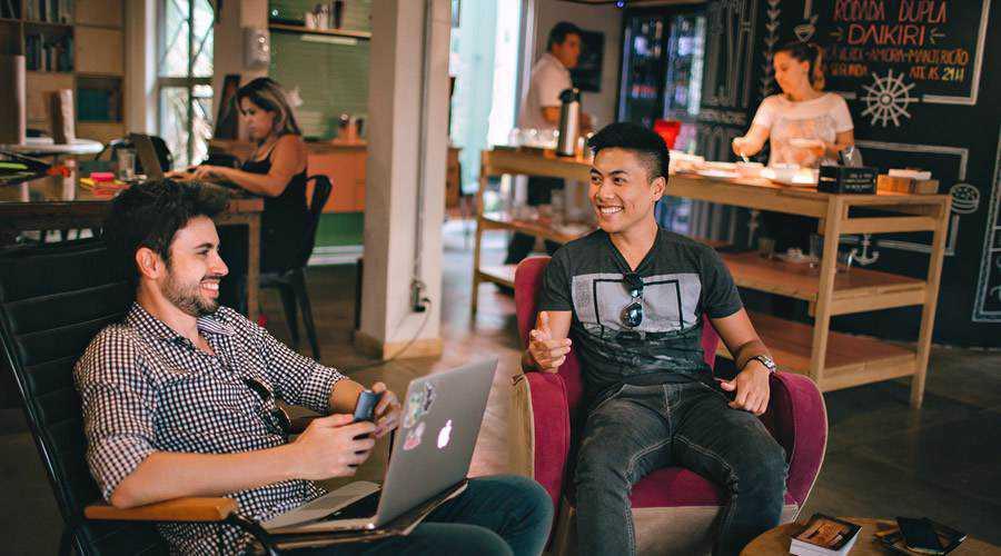 coffee meeting clients smile men happy laptop