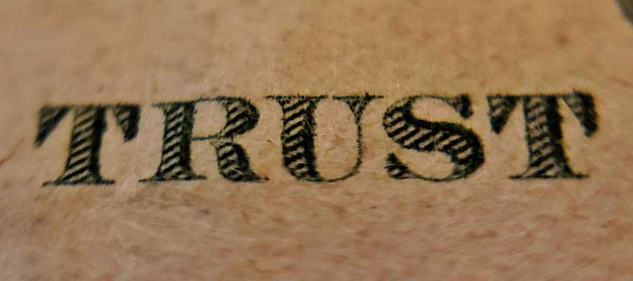 "The word ""TRUST"" printed on currency."