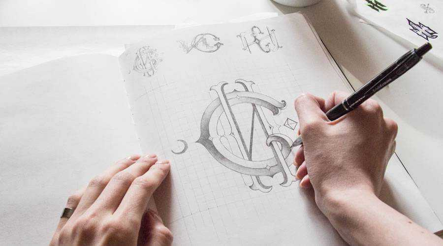 Monogram logo design sketch paper pencil pen inspiration