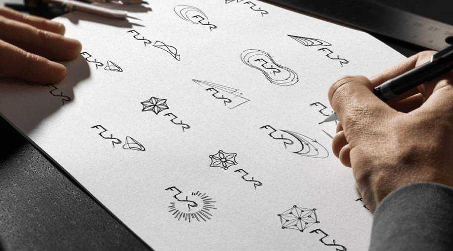 FLYR logo design sketch paper pencil pen inspiration