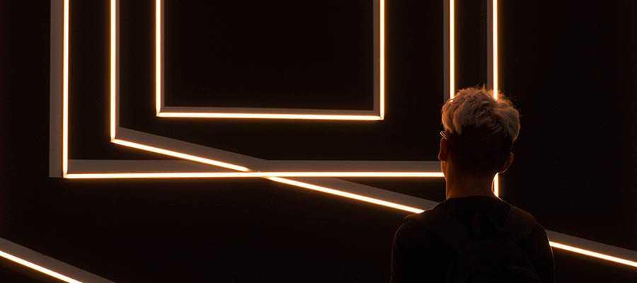 A person viewing futuristic art.