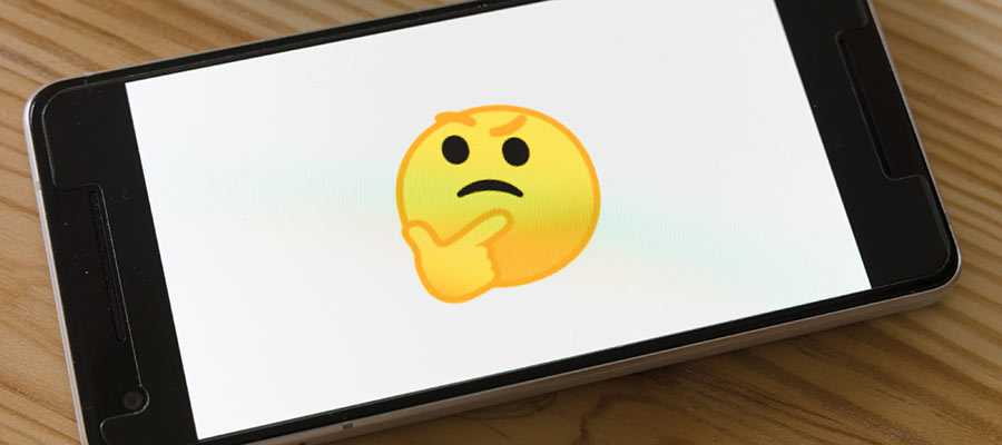"A ""thinking"" emoji displayed on a phone."