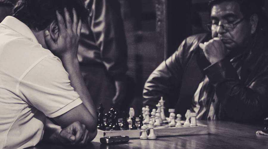 chess players black white focus designer
