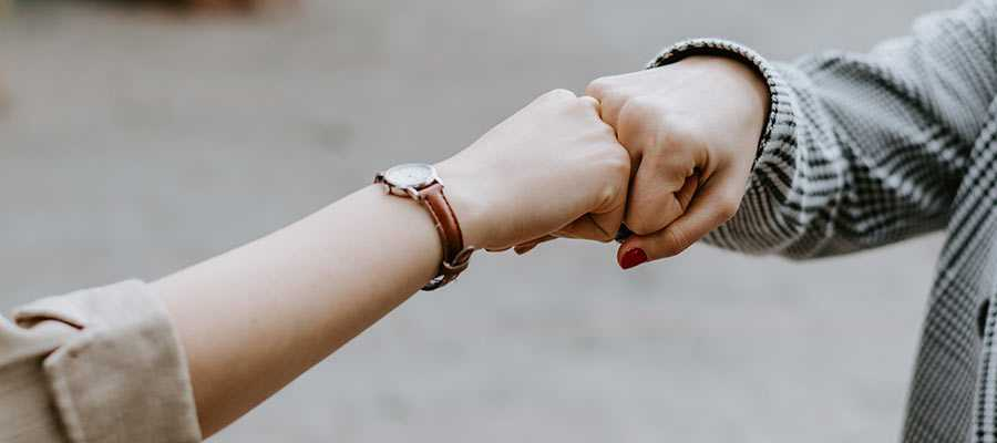 Two people engaging in a fist bump.
