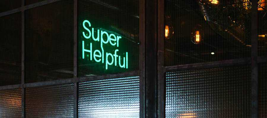 """A sign that reads: """"Super Helpful""""."""