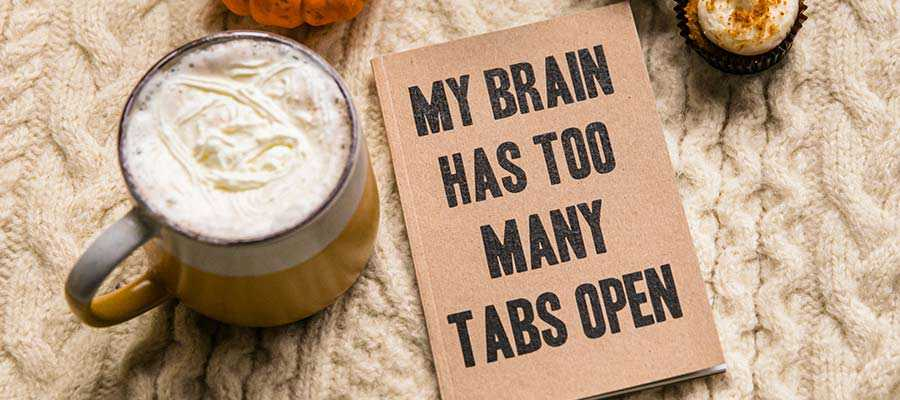 """A sign that reads, """"My brain has too many tabs open""""."""