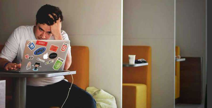 sad designer working laptop
