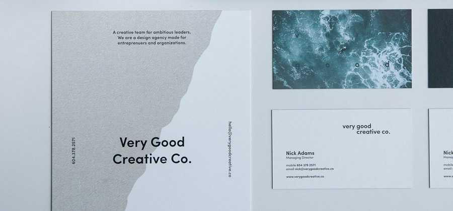 selection of branded designer business cards documents